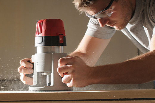 Man using a wood router